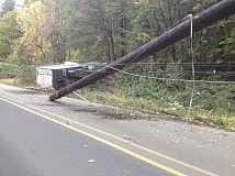 SUBMITTED PHOTO - A delivery truck crashed into a Sherwood power line Friday, trapping the driver inside.
