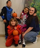 SPOKESMAN PHOTO: JAKE BARTMAN - From left: Marco Velazquez, 9, Dylan Williams, 9, Jocelyn Hammons-Acosta, 6, and mother Shanoa Hammons-Williams, who has been at Coffee Creek Correctional's minimum security facility since early 2014. Hammons-Williams is scheduled to be released spring 2019.