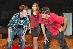 DAVID F. ASHTON - Franklin High student actors Max Platt-Devlin (who plays Nick Bottom), Anna Bell (as Tom Snout and the Wall), and Jared Roper (as Francis Flute), together work out a scene from the schools upcoming production of A Midsummer Nights Dream.