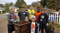 PHOTO COURTESY: LESLIE ROBINETTE -  Gladstone High athletes Mitchell Kuhn, Keegan Reilly, Matthew Schroedl, Cami Williams, and Emily Tunon help first grader Jayden Browning tackle yard work and painting projects for a neighbor.