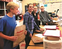PEGY SAVAGE - Max Kavanagh, Irina Sanarov, Tierra Sisk and A.J. Deardorff count bags to distribute around Molalla neighborhoods for the clubs upcoming Trick-or-Treat Canned Food Drive.