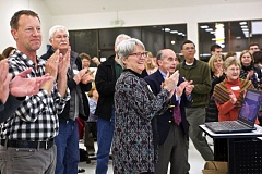 TIMES PHOTO: JAIME VALDEZ - Amy Grant (center), former board president of the Aloha Community Library Association, celebrates with supporters the passage of Washington County Cooperative Library Services levy on Tuesday night.
