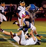 LON AUSTIN/CENTRAL OREGONIAN - Cole Ovens attempts to break through a tackle in the Cowboys' win over the Henley Hornets Friday night. Ovens finished the game with 112 yards on 15 carries.