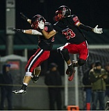 JOHN LARIVIERE - Josh Gay (left) and Cole Turner (83) leap sky-high as they celebrate a two-point conversion following a fourth quarter touchdown. The conversion tied the score at 21-21 with 9:42 left to play. Clackamas added two more touchdowns down the stretch en route to a 35-21 victory.