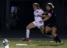 JON HOUSE - La Salle senior forward Regan Russell goes on the attack in last weeks state playoff game with ninth-ranked Silverton. Russell scored twice in the Falcons 3-0 win, and she assisted on the third tally.