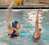 JAN KAVALE - Over the top -- Mackenzie Russell lifts a pass over a defender during Newberg's 20-5 win over Sunset in the 6A state quarterfinals Saturday at the Osborn Aquatic Center in Corvallis. The Tigers will continue their quest for a state championship with a semifinal contest versus Reynolds at 8:30 p.m. Friday in Corvallis.