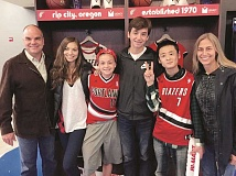 SUBMITTED PHOTO - The Grano family attended a Portland Trailblazers game with their Sister City program delegate Kakeru Endo. From left: Dave, Zoey, Ellie and Nick Grano; Kakeru Endo of Kitakata, Japan; and Karin Grano.