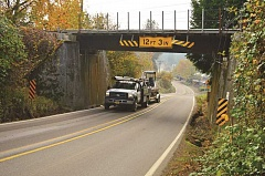 SPOKESMAN PHOTO: JAKE BARTMAN - Improvements to the Grahams Ferry Road rail undercrossing, which periodically becomes an obstacle for large vehicles, will be funded by the new Coffee Creek Urban Renewal Area.