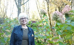 ESTACADA NEWS PHOTO: EMILY LINDSTRAND - Norma Piper stands in front of her garden, where she often finds inspiration.