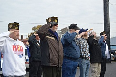 SPOTLIGHT PHOTO: NICOLE THILL - Left to right: Veterans Dave Sleightam, John Vincent, Richard Burdett, Benjamin Tait, Jim Wilson and Bill Warner salute during a POW/MIA flag raising ceremony held at the St. Helens Police Department on Friday, Nov. 7. Several classes of students from Lewis and Clark Elementary School also attended the ceremony held early in the morning.