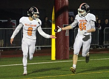 TIMES PHOTO: MILES VANCE - Beaverton's Carson Crawford (left) accepts congratulations from teammate King Weatherly after Crawford scored the clinching touchdown in his team's 21-14 win over Tualatin at Tualatin High School in the second round of the Class 6A state playoffs on Friday night.