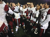 TRIBUNE PHOTO: JEFF SMITH - The Clackamas Cavaliers whoop it up after defeating the Central Catholic Rams on Friday at Hillsboro Stadium.