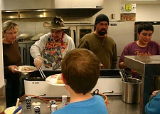 CENTRAL OREGONIAN FILE PHOTO - The Kids Club Thanksgiving Dinner draws hundreds of hungry visitors to Crook County High School.