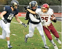 SETH GORDON - Nowhere to run - Jesse Bresser and Dominick Fix-Gonzalez close in to tackle Willamette's Taylor Livingston for a loss during George Fox's 21-14 win Saturday at Stoffer Family Stadium. 