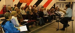 SUBMITTED - The Molalla Community Choir practices for the upcoming holiday concert season, Don Newell directing.