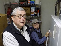 GAZETTE PHOTO: RAY PITZ - Gerry and Dottie Edy, shown here in what started as storage for Helping Hands, the janitor's closet at Sherwood United Methodist Church, have been directors of the food pantry for a decade.
