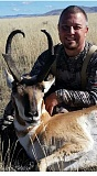 SUBMITTED PHOTO - Marty Liesegang poses with the pronghorn antelope he brought down while hunting in Montana. By planning ahead, out-of-state hunts can be enjoyable, low-stress adventures.
