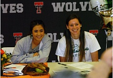 DAN BROOD - Tualatin High School seniors Caitlyn Sung (left) and Hannah Self each signed their national letters of intent Monday during a ceremony held at the school.