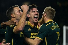 TRIBUNE PHOTO: DAVID BLAIR - Liam Ridgewell is the center of attention after the scoring the first goal of the MLS Western Conference finals for Portland.