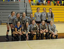 LON AUSTIN/CENTRAL OREGONIAN - The Crook County High School volleyball team poses with their third place trophy at this year's state tournament.