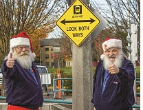 HILLSBORO TRIBUNE PHOTOS: TRAVIS LOOSE -  Mark Larson (left) and Bob Foster are certified as both bus operators and Santas.