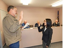 BARBARA SHERMAN - Chi Nguyen-Ventura takes the oath of office administered by City Manager Dave Wells to join the King City City Council at its Nov. 4 meeting.