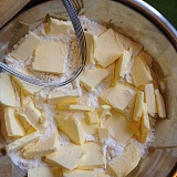 PHOTO COURTESY OF SARAH WEST - Some scratch cooking methods can take practice, such as cutting cold butter into flour (as pictured). But cooking from scratch can also be as simple as frying an egg, Sarah West says.
