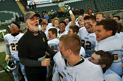 PAMPLIN MEDIA GROUP: VERN UYETAKE - West Linn coach Chris Miller celebrates with his team along the sideline in the closing moments of the Lions' 51-7 victory over Sherwood on Saturday.