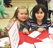 CONTRIBUTED PHOTO: POWELL VALLEY ELEMENTARY  - Two Powell Valley students work on handmade holiday cards from a festival past.