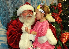 SPOKESMAN PHOTO: VERY UYETAKE - Kenna Bettelyoun and her daughter Felicity enjoy the Santas Winter Wonderland Saturday morning.