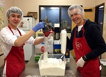 SUBMITTED PHOTO - Lake Oswego Junior High School eighth-graders Kevin Amborn (left) and Michael Murray repackage food into smaller portions at the Tualatin School House Pantry.