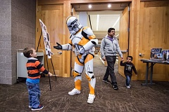 TIMES PHOTO: JONATHAN HOUSE - Scott Thingelstad, dressed as a clone trooper, greets children at the Beaverton Library for a Star Wars event.