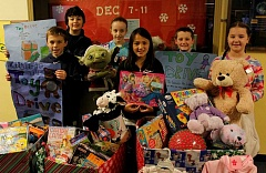 REVIEW PHOTO: JILLIAN DALEY - Every fifth-grader at Lake Grove Elementary School helped out with the annual toy drive, including (from left): back row, Dylan Dougherty, Sara Dougherty, Blake Hilliker and Lauren Shimota; and front row, Kyle Brennan and Megan Ko.