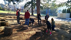 "COURTESY OF ANDY JENSEN - Up to two dozen volunteers helped Sheldon Jensen turn his design for a play area at Sherwood Charter School into reality, turning a pile of stumps cut from trees on the property into giant ""stepping stones."""