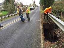TIMES PHOTO: JAIME VALDEZ - A deep sinkhole opened up along Southwest Beef Bend Road on Tuesday, closing the road for at least the next few days.