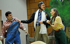 REVIEW PHOTO: VERN UYETAKE - 'The Elixir of Love' protagonist Nemorino, played by Matt Chittick (left), is being overshadowed by rival Sgt. Belcore, played by Rameen Chaharbaghi, for the affections of the wealthy Adina, played by Ainsley Soutiere. Nemorino resorts to buying a love potion from charlatan Dr. Dulcamara, played by Rocky Sellers (not pictured). Students at Park Academy in Lake Oswego enjoyed a performance of Elixir by Portland Opera to Go last week.