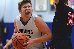 THE OUTLOOK: DAVID BALL - Barlows Matt Ellis fights his way into the lane against Thurston defender Decker Tovey during the Bruins 58-41 semifinal win Tuesday night.