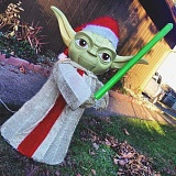 SUBMITTED PHOTO - Local teens out a holiday pranking mission nabbed a Yoda decoration. Sherwood police later found the item, returning it to a grateful owner.