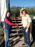 SUBMITTED PHOTO: CRAIG PIERINGER - Andrew Pieringer shakes hands with Lake Oswego Hunt manager Katie Purdy after completing his Eagle Scout project, which involved rebuilding a set of stairs for the Hunt.