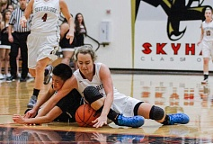 HILLSBORO TRIBUNE PHOTO: CHASE ALLGOOD - Century's Jade Bevandich (left) and Southridge's Alyssa Christiansen wrestle for a loose ball during Southridge's 45-38 win Friday.