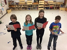 PHOTO COURTESY: LESLIE ROBINETTE - Hudson Winfrey, Leesa Jo, Isabella Kuther, and Carver Kolln rehearse for their All-State Choir performance in January.