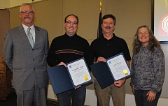 CONTRIBUTED PHOTO: GRESHAM-BARLOW SCHOOL DISTRICT - Gresham-Barlow superintendent Jim Schlachter (far left) and board chair Carla Piluso congratulate Christopher Alsop (glasses) and Scott McCoy on renewing their National Board Certification.