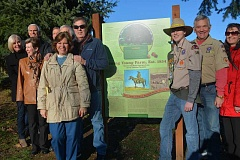 SUBMITTED PHOTO - Jake Whitehurst, middle right, stands by his completed project with friends and family at an unveiling Sunday, Jan. 10.