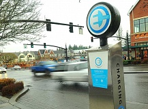 REVIEW PHOTO: VERN UYETAKE - Fossil fuels and the environment were on the minds of members of the Student Writers Advisory Group. Theres a place to charge your electronic vehicle on A Avenue in front of the Shell station in Lake Oswego.