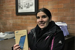 OUTLOOK PHOTO: KATY SWORD - Virginia Young, 32, of Troutdale, won The Outlook's Facebook social media contest and the Samsung tablet pictured here.
