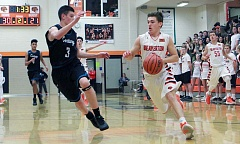 TIMES PHOTO: MILES VANCE - Beaverton's Wyatt Christopherson drives during his team's 61-58 win over Century at Beaverton High School on Friday night.
