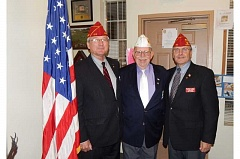 BARBARA SHERMAN - Dale Barnett (left), American Legion national commander, paid a visit to Tigard American Legion Post 158 on Dec. 19, meeting with state Commander Mike Jones (center) and Charlie Schmidt, who is expected to become the first Oregon national commander next year.