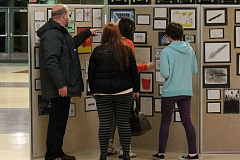 SPOKESMAN PHOTO: ANDREW KILSTROM - Inza R. Wood Middle School Principal Jim Severson (left) admires some student artwork with parents.