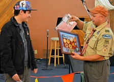SPOKESMAN PHOTO: JAKE BARTMAN - Palacios, left, is presented with his honorary rank advancements by Troop 194 Scoutmaster John Budiao.