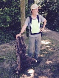 SUBMITTED PHOTO - Jim Fisher, one of the coordinators of the Friends of Hallinan Heights Woods, stands with an English ivy stalk he removed from the natural area.